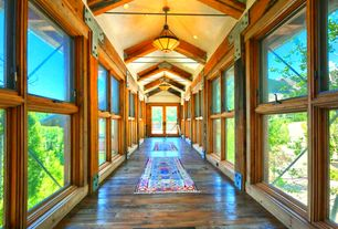Country Hallway with Exposed trusses, flush light, Carpet runner, High ceiling, French doors, Hardwood floors, Exposed beam