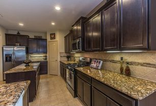 Traditional Kitchen with Kitchen island, flush light, Flat panel cabinets, limestone tile floors, L-shaped, Stone Tile