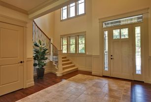 Traditional Entryway with Laminate floors, flat door, Transom window, double-hung window, Standard height, Crown molding