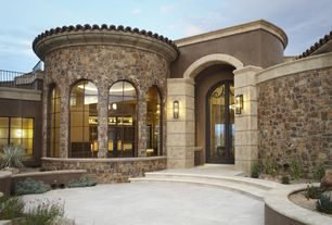 Mediterranean Front Door with French doors, Fence, Raised beds, Arched window, exterior tile floors, exterior stone floors