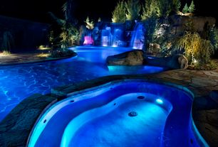 Rustic Swimming Pool with exterior stone floors, Pool with hot tub, Fountain, Fence
