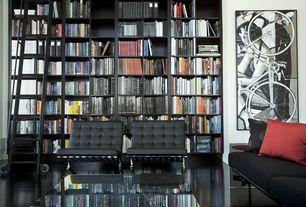 Modern Living Room with Hardwood floors, Barcelona chair, Standard height, Built-in bookshelf