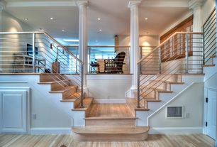 Modern Staircase with Metal and wood stair railing, Double staircase, Mezzanine, High ceiling, Columns, Hardwood floors