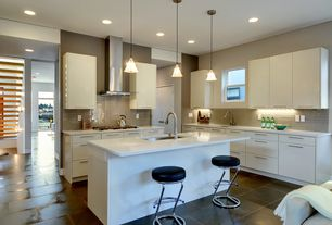 Modern Kitchen with Corian counters, L-shaped, Pendant light, Large Ceramic Tile, Breakfast bar, European Cabinets, Flush