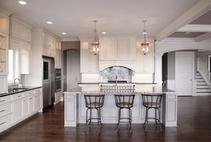 Traditional Kitchen with Open plan, Complex marble counters, Custom Cabinetry by Covenant Woodworks, Crown molding, Archway