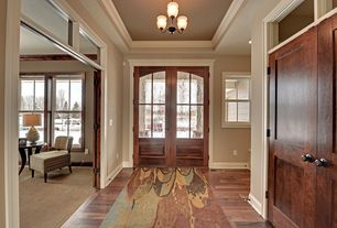 Craftsman Entryway with Transom window, Standard height, Hardwood flooring, six panel door, Hardwood floors, Chandelier