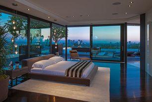 Contemporary Master Bedroom with sliding glass door, can lights, Standard height, floor to ceiling window, Hardwood floors