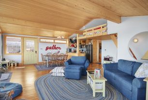 Country Great Room with Built-in bookshelf, Wall sconce, Glass panel door, Exposed beam, picture window, Loft, Mural