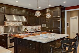 Traditional Kitchen with Stone Tile, can lights, Slate Tile, Wall Hood, Framed Partial Panel, full backsplash, specialty door