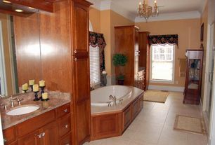 Traditional Master Bathroom with Crown molding, Undermount sink, drop in bathtub, Raised panel, Framed Partial Panel, Flush
