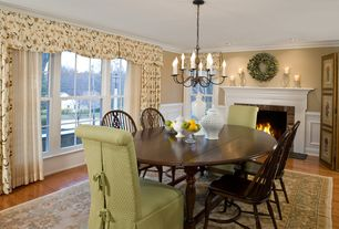 Traditional Dining Room with Hardwood floors, Chandelier, Crown molding, Wainscotting, Cement fireplace
