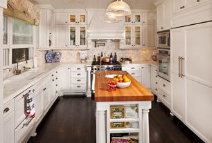 Traditional Kitchen with Kitchen island, Glass panel, Wood counters, Pendant light, Complex marble counters, Undermount sink