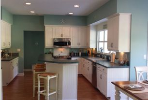Cottage Kitchen with Napoleon Backless Barstool, Slate counters, Raised panel, Casement, U-shaped, Hardwood floors, Slate