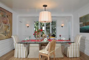 Traditional Dining Room with Pendant light, Standard height, Wainscotting, Crown molding, can lights, Wall sconce, Casement
