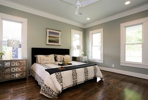 Contemporary Master Bedroom with Ceiling fan, can lights, Table lamp, Standard height, Crown molding, double-hung window