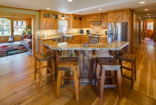 """Rustic Kitchen with L-shaped, Glass panel, European Cabinets, Breakfast bar, Flush, Montana woodworks homestead 30"""" barstool"""