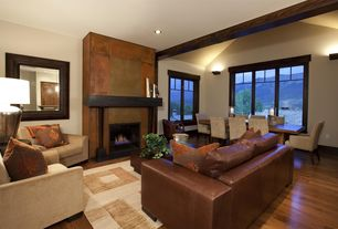Contemporary Living Room with Exposed beam, Fireplace, Steel fireplace surround, Standard height, Cement fireplace, Casement