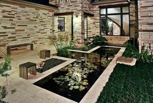 Contemporary Landscape/Yard with Exterior accent lighting, Koi pond, Exterior stone siding, Linear stainless steel bench