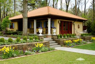 Traditional Landscape/Yard with Pathway, Glass panel door, Raised beds, Casement, exterior stone floors, Fence