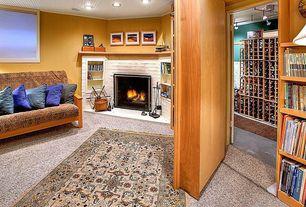 Country Living Room with Hidden door wall system, Carpet, Ikea Hutten 9-Bottle Stacking Wine Rack, Built-in bookshelf