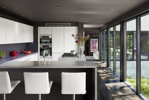 Contemporary Kitchen with Kitchen island, Flush, European Cabinets, Corian counters, U-shaped, Breakfast bar