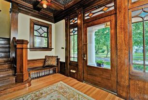 Craftsman Entryway with Window seat, flush light, Crown molding, Hardwood floors, Stained glass window, French doors