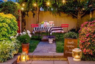Eclectic Patio with exterior stone floors, Ikea malaro folding chair, Pathway, Fence, Crate & barrel globe string lights