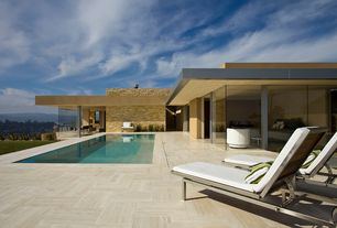 Contemporary Swimming Pool with exterior terracotta tile floors, Lap pool, picture window, sliding glass door, Pathway