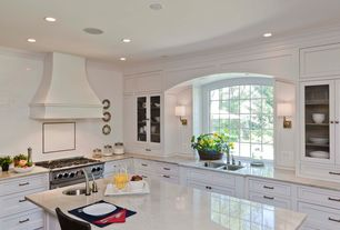 Contemporary Kitchen with Flat panel cabinets, Glass panel, L-shaped, Crown molding, Inset cabinets, Custom hood, Wall sconce