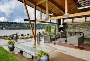 Contemporary Porch with Outdoor kitchen, Fence, exterior tile floors