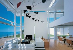 Contemporary Living Room with Invisible Coffee Table, Rectangle, Calder Inspired Mobile, Skylight, High ceiling, Columns