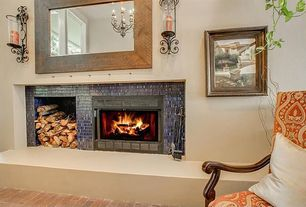 Eclectic Living Room with Fireplace, Wall sconce, Cement fireplace, Brick floors, Standard height