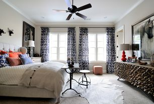 Eclectic Master Bedroom with Robert abbey - triple gourd ceramic table lamp, Ceiling fan, can lights, Carpet, Paint