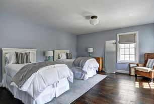 Contemporary Guest Bedroom with Seagrass wingback armchair, flush light, double-hung window, Paint, Hardwood floors