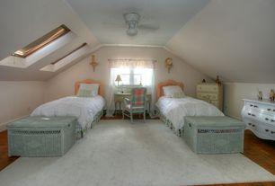 Traditional Guest Bedroom with Casement, Standard height, Ceiling fan, Hardwood floors, Skylight