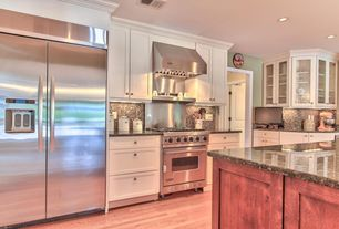 Craftsman Kitchen with Sandstone counters, Wall Hood, can lights, Flat panel cabinets, L-shaped, Paint, Ceramic Tile