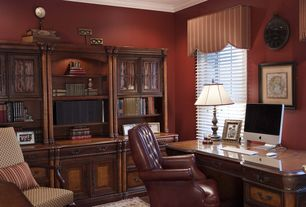 Traditional Home Office with Hardwood floors, Crown molding, specialty window, Built-in bookshelf, Standard height