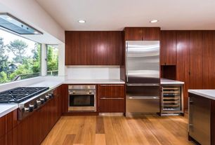 Contemporary Kitchen with wall oven, Bay window, Flush, electric cooktop, Kitchen island, can lights, Wine refrigerator