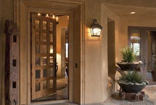 Mediterranean Front Door with Raised beds, exterior stone floors, French doors, Glass panel door