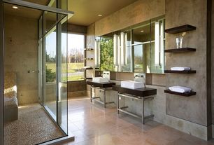 Contemporary Master Bathroom with can lights, Polished mixed pebble tile, Console sink, Soapstone counters, framed showerdoor