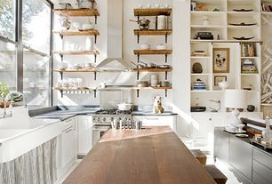 Contemporary Kitchen with gas range, Farmhouse sink, Built-in bookshelf, Slate counters, Breakfast bar, Standard height