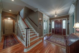Traditional Entryway with Hardwood floors, flush light, Crown molding, six panel door, Wall sconce, Stained glass window
