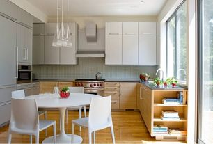 Contemporary Kitchen with Soapstone counters, Grid ii 3 light pendant, European Cabinets, Undermount sink, Bellini chair