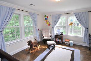 Traditional Kids Bedroom with Storkcraft Hoop Glider & Ottoman, Safavieh Himalayan Beige & Dark Brown Area Rug, flush light