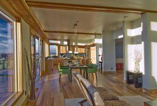 Contemporary Great Room with Exposed beam, Pendant light, Built-in bookshelf, Hardwood floors
