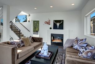 Contemporary Living Room with Paint, Hardwood floors, Fireplace, can lights, insert fireplace, Columns, Wall sconce