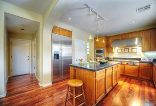 Modern Kitchen with High ceiling, Flat panel cabinets, Pendant light, Kitchen island, Complex granite counters, U-shaped