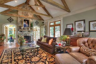 Rustic Living Room with Beacon tufted leather chair in bronco whiskey, Ceiling fan, French doors, Transom window