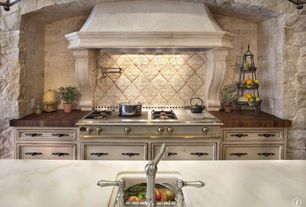 Mediterranean Kitchen with Flat panel cabinets, Framed Partial Panel, Standard height, full backsplash, Limestone Tile