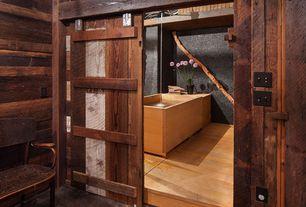 Eclectic Full Bathroom with High ceiling, Hardwood floors, specialty door, Polished concrete floor, Freestanding